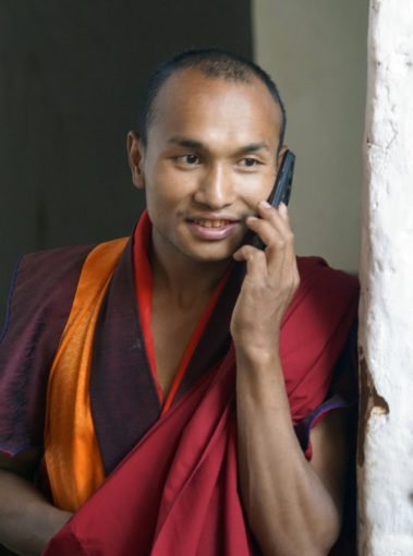 Monk on cellphone